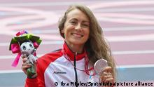 03.09.2021 Silver medalist Russian Paralympic Committee's Aleksandra Moguchaia poses during the awarding ceremony for the women's long jump T47 athletics event at the Tokyo 2020 Paralympic Games at Olympic Stadium in Tokyo, Japan. Ilya Pitalev / Sputnik