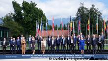 European Union foreign ministers pose for a group photo during a meeting of EU foreign ministers at the Brdo Congress Center in Kranj, Slovenia, Friday, Sept. 3, 2021. European Union officials listed Friday a set of conditions to the Taliban including the respect of human rights and rule of law that should define the level of engagement the 27-nation bloc will develop with the new Afghanistan rulers. (AP Photo/Darko Bandic)