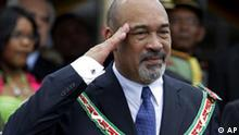 Suriname's President Desi Bouterse salutes during a military parade after his swearing in ceremony in Paramaribo, Suriname, Thursday, Aug. 12, 2010. Bouterse, a former coup leader, convicted drug trafficker and accused murderer is on trial for his alleged role in the abduction and summary execution of fifteen suspected enemies of his military regime in Dec. 1982. No foreign heads of state attended the inauguration. (AP Photo/Andres Leighton)