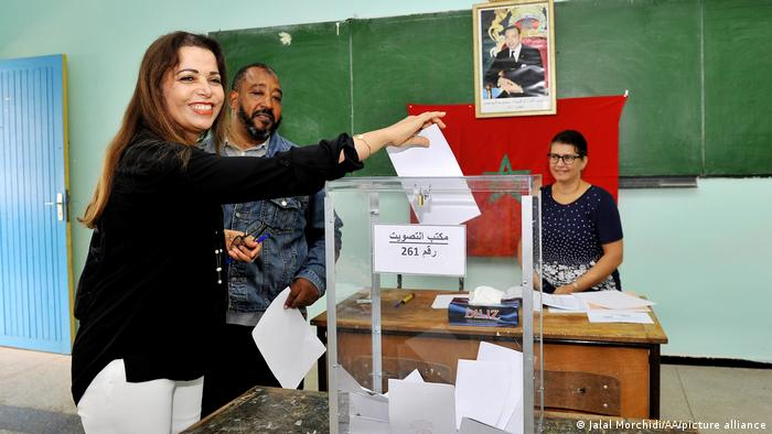 A citizen is seen at a polling station to cast her vote during the parliamentary elections in Casablanca.