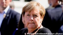 German Chancellor Angela Merkel looks on during her visit in the flood-damaged city Altenahr, Germany, Friday, Sept. 3, 2021. After days of extreme downpours causing devastating floods hit the valley of the river Ahr in July. (AP Photo/Markus Schreiber, Pool)