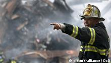010914-N-3995K-003 Retired fire chief Joseph Curry barks orders to rescue teams as they clear through debris that was once the World Trade Center Sept. 14, 2001, in New York. (U.S. Navy photo by Journalist 1st Class Preston Keres) (RELEASED) [Photo via Newscom] pubmilpics005935 (edisto collection)