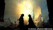 Rays of light burst off a building at One Liberty Plaza to silhouette two firefighters who are surveying Ground Zero at dawn on September 15, 2001 in New York City. September 11, 2011 marks the tenth anniversary of the terrorist attacks on the World Trade Center, Pentagon and the crash of flight 93 in Shanksville, Pennsylvania. UPI/Chris Corder Photo via Newscom picture alliance