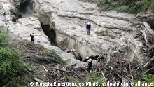REPUBLIC OF DAGESTAN, RUSSIA - AUGUST 24, 2021: A search and rescue operation is held at the site of a mudslide in the Gunib District. Rescuers have evacuated 15 tourists that were blocked at the Karadakhskaya Tesnina due to a rise in water level in the Kvartal River. One tourist got swept away in floodwaters. Best quality available. Dagestan Republic Branch of the Russian Emergencies Ministry/TASS