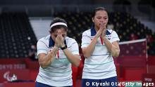 TOKYO, JAPAN - SEPTEMBER 04: Oktila Leani Ratri (L) and Sadiyah Khalimatus (R) of Team Indonesia celebrate the Badminton Women's Doubles Sl3-SU5 Gold Medal Match against Cheng Hefang and Ma Huihui of Team China on day 11 of the Tokyo 2020 Paralympic Games at Yoyogi National Stadium on September 04, 2021 in Tokyo, Japan. (Photo by Kiyoshi Ota/Getty Images)