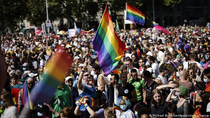 Marchers wave rainbow flags in a march in the Swiss capital Zurich attended by thousands.