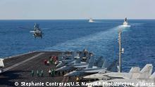 In this Tuesday, Nov. 19, 2019, photo made available by U.S. Navy, a helicopter lifts off of the aircraft carrier USS Abraham Lincoln as it transits the Strait of Hormuz. The U.S. aircraft carrier Abraham Lincoln sent to the Mideast in May over tensions with Iran transited the narrow Strait of Hormuz for the first time on Tuesday. The ship previously had been in the Arabian Sea outside of the Persian Gulf. (Mass Communication Specialist Seaman Stephanie Contreras/U.S. Navy via AP)