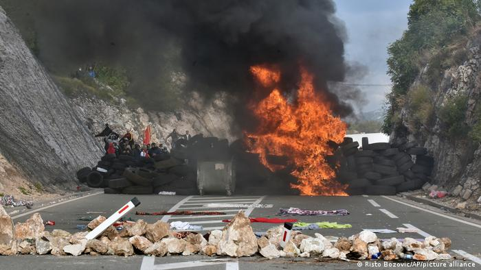 Protesters set fire to car tires at one of the blockades near Cetinje, Montenegro