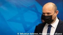 Israeli Prime Minister Naftali Bennett arrives for the weekly cabinet meeting at the Prime Minister's office in Jerusalem, Sunday, Sept. 5, 2021. (AP Photo/Sebastian Scheiner, Pool)