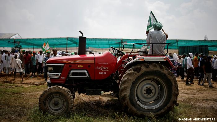 A farmer sits on his tractor at a protest in Muzaffarnagar, India