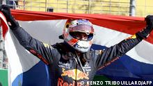 Red Bull's Dutch driver Max Verstappen celebrates in the parc ferme at the Zandvoort circuit after winning the Netherlands' Formula One Grand Prix in Zandvoort on September 5, 2021. (Photo by Kenzo Tribouillard / AFP)