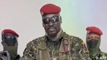 A screengrab taken from footage sent to AFP by a military source on September 5, 2021 shows Guinean Colonel Doumbouya delivering a speech following the capture of the President of Guinea Conakry and the dissolution of the government during a coup d'etat in Conakry on September 5, 2021. - Turmoil engulfed the impoverished west African nation of Guinea again on September 5, 2021 as army putschists said they had captured the president and staged a coup, and the government insisted it has repelled the attack. We have decided, after having taken the president, to dissolve the constitution, said a uniformed officer flanked by soldiers toting assault rifles in a video sent to AFP. (Photo by - / MILITARY SOURCE / AFP) / RESTRICTED TO EDITORIAL USE - MANDATORY CREDIT AFP PHOTO / MILITARY SOURCE - NO MARKETING - NO ADVERTISING CAMPAIGNS - DISTRIBUTED AS A SERVICE TO CLIENTS