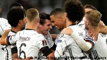 Germany's scorer Jonas Hofmann, center left, and his teammates celebrate their side's fifth goal during the World Cup 2022 group J qualifying soccer match between Germany and Armenia at Mercedes-Benz Arena stadium in Stuttgart, Germany, Sunday, Sept. 5, 2021. (AP Photo/Matthias Schrader)