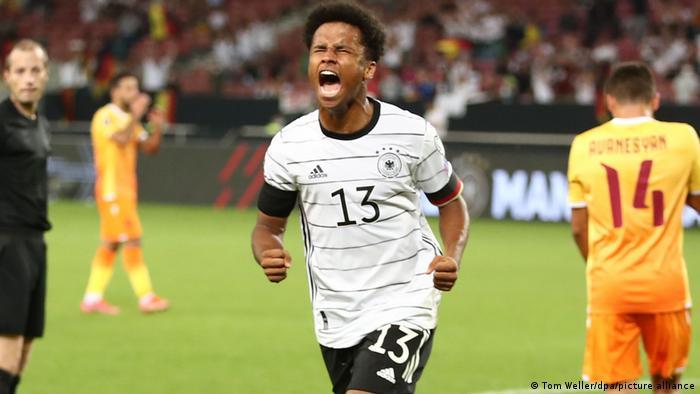 Karim Adeyemi celebrates after scoring a goal for Germany