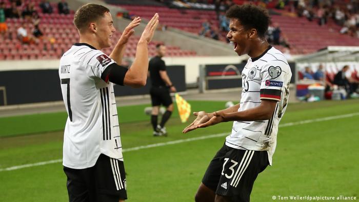 Karim Adeyemi (right) celebrates with Germany teammate Florian Wirtz