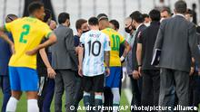 Argentina's Lionel Messi and Brazil's Neymar talk as the soccer game is interrupted by health authorities during a qualifying soccer match for the FIFA World Cup Qatar 2022 at Neo Quimica Arena stadium in Sao Paulo, Brazil, Sunday, Sept.5, 2021. (AP Photo/Andre Penner)