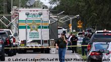 Polk County, Fla., Sheriff's officials work the scene of a multiple fatality shooting Sunday, Sept. 5, 2021, in Lakeland, Fla. Four people are dead including a mother who was still cradling her now deceased baby in what Florida sheriff's deputies are calling a massive gun battle with a suspect. (AP Photo/Lakeland Ledger, Michael Wilson)