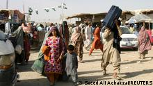 Members of a family from Afghanistan with their belongings cross into Pakistan at the Friendship Gate crossing point at the Pakistan-Afghanistan border town of Chaman, Pakistan, September 3, 2021. REUTERS/Saeed Ali Achakzai