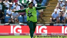 LEEDS, ENGLAND - JULY 18: Azam Khan of Pakistan celebrates after catching Dawid Malan of England during the second Vitality International T20 match between England and Pakistan at Emerald Headingley Stadium on July 18, 2021 in Leeds, England. (Photo by Shaun Botterill/Getty Images)