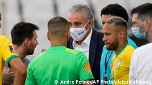 Argentina's Lionel Messi, left, talks to Brazil's coach Tite and Brazil's striker Neymar, right, after the qualifying soccer match for the FIFA World Cup Qatar 2022 was interrupted by health officials at Neo Quimica Arena stadium in Sao Paulo, Brazil, Sunday, Sept.5, 2021. Argentina walked off the field shortly after the start of the South American classic when health officials came onto the pitch following coronavirus concerns about some Argentina players.(AP Photo/Andre Penner)