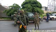 Army soldiers hold a checkpoint after the uprising that led to the toppling of President Alpha Conde in Kaloum neighbourhood of Conacry in Guinea, September 6, 2021. REUTERS/ Souleymane Camara NO RESALES. NO ARCHIVES