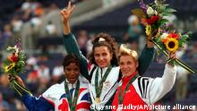 Heptathlon gold medalist Ghada Shouaa of Syria is flanked by Natasha Sazanovich of Belarus, right, silver and Denise Lewis of Great Britain, bronze during the presentation ceremony at the 1996 Summer Olympic Games in Atlanta, Monday, July 29, 1996. (AP Photo/Lynne Sladky)