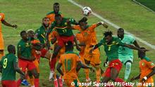Ivory Coast's and Cameroon's players fight for the ball during the FIFA Qatar 2022 World Cup qualification football match between Ivory Coast and Cameroon at the Alassane Ouattara Ebimpe stadium Anyama on September 6, 2021. (Photo by Issouf SANOGO / AFP) (Photo by ISSOUF SANOGO/AFP via Getty Images)