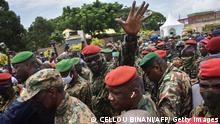 Lieutenant Colonel Mamady Doumbouya, head of the Armys special forces and coup leader, waves to the crowd as he arrives at the Palace of the People in Conakry on September 6, 2021, ahead of a meeting with the Ministers of the Ex-President of Guinea, Alpha Conde. - Lieutenant Colonel Mamady Doumbouya, the leader of the latest coup in Guinea, is a highly educated, combat-hardened soldier who once served in France's Foreign Legion. Doumbouya's special forces on September 5, 2021 seized Alpha Conde, the West African state's 83-year-old president, a former champion of democracy accused of taking the path of authoritarianism. (Photo by CELLOU BINANI / AFP) (Photo by CELLOU BINANI/AFP via Getty Images)