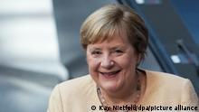 07.09.2021, Berlin - Bundeskanzlerin Angela Merkel (CDU) lächelt im Plenum im Deutschen Bundestag. In seiner voraussichtlich letzten Debatte Bundestags der Wahlperiode soll unter anderem über die Situation in Deutschland, die Entscheidung über Hochwasser-Aufbaufonds und Neuregelungen zu Corona beraten werden.