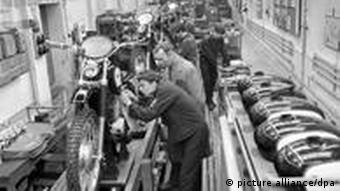 A black and white picture of workers on an assembly line