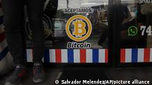 We accept Bitcoin is announced at a barber shop in Santa Tecla, El Salvador, Saturday, Sept. 4, 2021. Starting Tuesday, Sept. 7, all businesses will have to accept payments in Bitcoin, except those lacking the technology to do so. (AP Photo/Salvador Melendez)