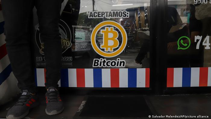 A sign on a window saying that Bitcoin is accepted
