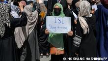 Afghan women take part in an anti-Pakistan protest near the Pakistan embassy in Kabul on September 7, 2021. - The Taliban on September 7, 2021 fired shots into the air to disperse crowds who had gathered for an anti-Pakistan rally in the capital, the latest protest since the hardline Islamist movement swept to power last month. (Photo by Hoshang Hashimi / AFP)