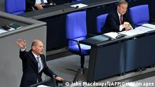 North Rhine-Westphalia's State Premier and Germany's conservative Christian Democratic Union's (CDU) chancellor candidate Armin Laschet (R) looks on as German Finance Minister and Vice-Chancellor Olaf Scholz gives a speech at the Bundestag, the German lower house of parliament, in Berlin on September 7, 2021. (Photo by John MACDOUGALL / AFP) (Photo by JOHN MACDOUGALL/AFP via Getty Images)