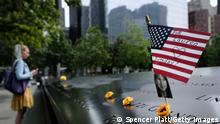 31.08.21 *** NEW YORK, NEW YORK - AUGUST 31: A U.S. flag is placed near a victim's name at the September 11 Memorial at Ground Zero on August 31, 2021 in New York City. New York City and much of the nation are preparing for the 20th anniversary of the terrorist attacks in both New York City and Washington D.C. Yesterday the United States officially ended its participation in the war in Afghanistan, a two-decade-long conflict that began shortly after the terrorist attacks of September 11, 2001. Almost 2,500 U.S. service members have died in the conflict, and thousands of Afghan troops, police personnel and civilians have also been killed. (Photo by Spencer Platt/Getty Images)