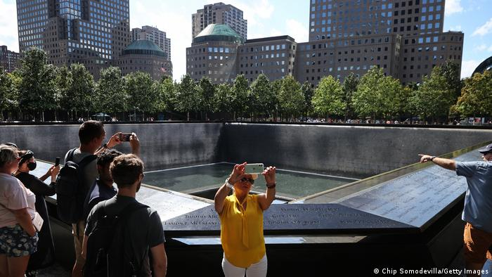 People gather at Ground Zero to take pictures