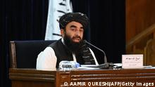 Taliban spokesman Zabihullah Mujahid addresses a press conference in Kabul on September 7, 2021. - The Taliban on September 7 announced UN-sanctioned Taliban veteran Mullah Mohammad Hassan Akhund as the leader of their new government, while giving key positions to some of the movement's top officials. (Photo by Aamir QURESHI / AFP) (Photo by AAMIR QURESHI/AFP via Getty Images)