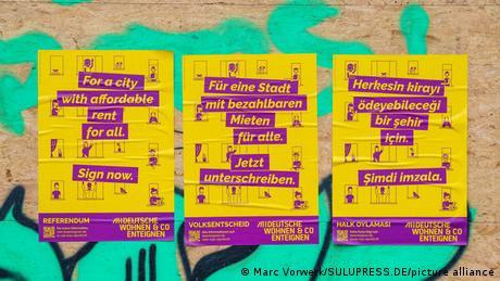 Berlin Initiative Deutsche Wohnen & Co showing posters in English, German and Turkish