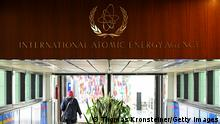 VIENNA, AUSTRIA - MAY 23: A woman walks past the sign of the International Atomic Energy Agency ahead of a press conference by Rafael Grossi, Director General of the IAEA, about the agency monitoring of Iran's nuclear energy program on May 23, 2021 in Vienna, Austria. The IAEA has been in talks with Iran over extending the agency's monitoring program. Meanwhile Iranian and international representatives have been in talks in recent weeks in Vienna over reviving the JCPOA Iran nuclear deal. (Photo by Thomas Kronsteiner/Getty Images)