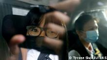 Hong Kong Alliance in Support of Patriotic Democratic Movements of China Vice-Chairwoman Tonyee Chow Hang-tung is seen inside a vehicle after being detained in Hong Kong, China, September 8, 2021. REUTERS/Tyrone Siu