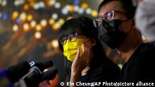 Chow Han Tung, left, vice chairwoman of the Hong Kong Alliance in Support of Patriotic Democratic Movements of China, and other group members attend a news conference in Hong Kong, Sunday, Sept. 5, 2021. The group behind the annual Tiananmen Square memorial vigil in Hong Kong said Sunday it will not cooperate with police conducting a national security investigation into the group's activities, calling it an abuse of power. (AP Photo/Kin Cheung)