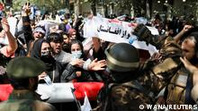 Taliban soldiers stand in front of protesters during the anti-Pakistan protest in Kabul, Afghanistan, September 7, 2021. WANA (West Asia News Agency) via REUTERS ATTENTION EDITORS - THIS IMAGE HAS BEEN SUPPLIED BY A THIRD PARTY.