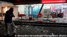 A man walks in from of a convenience store on a street covered with debris after a strong earthquake, in Acapulco, Mexico, Tuesday, Sept. 7, 2021. The quake struck southern Mexico near the resort of Acapulco, causing buildings to rock and sway in Mexico City nearly 200 miles away. (AP Photo/ Bernardino Hernandez)