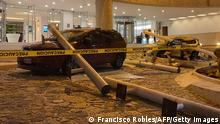 View of damaged cars outside a hotel after a quake in Acapulco, Guerrero state, Mexico on September 7, 2021. - A 6.9 magnitude earthquake struck Mexico on Tuesday near the Pacific coast, the National Seismological Service said, shaking buildings in the capital. The epicenter was 14 kilometers (nine miles) southeast of the beach resort of Acapulco in Guerrero state, the service said. (Photo by FRANCISCO ROBLES / AFP) (Photo by FRANCISCO ROBLES/AFP via Getty Images)