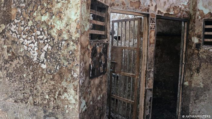 The gutted interior of a cell block in an overcrowded jail in Indonesia