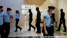 French Gendarmes and police secure outside the temporary courtroom set up at the Paris courthouse on the Ile de la Cite before the start of the trial of the Paris' November 2015 attacks, in Paris, France, September 8, 2021. Twenty defendants stand trial over Paris' November 2015 attacks from September 8, 2021 to May 25, 2022, with nearly 1,800 civil parties, more than 300 lawyers, hundreds of journalists and large-scale security challenges. REUTERS/Gonzalo Fuentes
