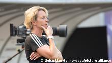 Martina Voss-Tecklenburg on the sidelines