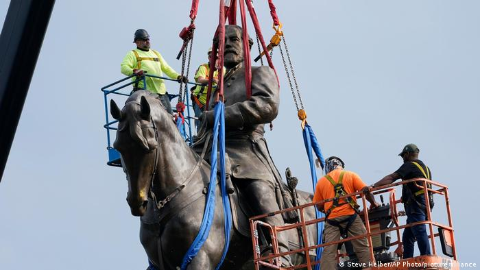 Crews work to remove one of the country's largest remaining monuments to the Confederacy, a towering statue of Confederate General Robert E. Lee in Richmond