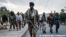 (FILES) In this file photo taken on June 29, 2021 Rebels that are pro-TPLF (Tigray People's Liberation Front) arrive after eight hours of walking in Mekele, the capital of Tigray region, Ethiopia, on June 29, 2021. - Rebels from Ethiopia's war-hit Tigray killed at least 125 residents of a village in the neighbouring Amhara region earlier this month before being driven out by pro-government forces, doctors said on September 8, 2021. There were 125 dead in Chenna village... I saw the mass grave myself, Mulugeta Melesa, head of the hospital in nearby Dabat town, told AFP, adding that residents were still searching for dead bodies around the area and counting is still going on. (Photo by Yasuyoshi Chiba / AFP)