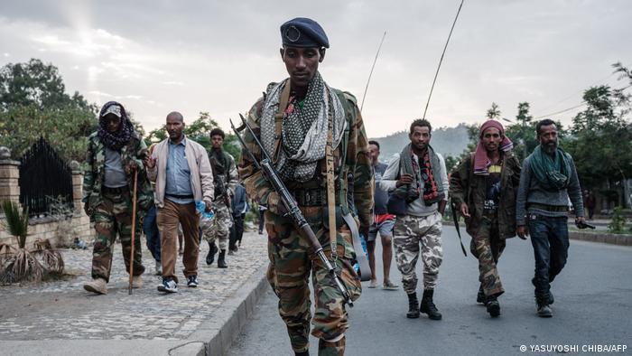 Pro-TPLF rebels walk along a road in Mekele, Tigray
